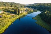 Top view of Vazhinka river in Soginicy village. Green forests of Leningrad region and Republic of Karelia, Russia.