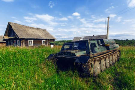 Abandoned all-terrain vehicle. Old village houses.