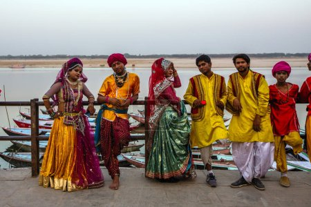 VARANASI, INDIA - MAR 22, 2018: Pilgrims on the waterfront holy Ganges river in the early morning. According to legends, the city was founded by God Shiva about 5000 years ago.