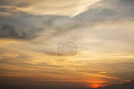 Photo for Cloudy blue sky during an amazing sunset. - Royalty Free Image