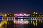 Night view from the Vistula river to the old city in Warsaw