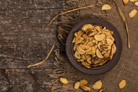 Photo for Roasted Garlic Slices. Selective focus. - Royalty Free Image