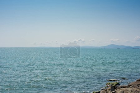 A ship on the horizon of the blue sea. Nature background.