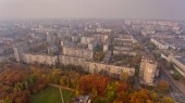 Aerial view of the colorful autumn city. Beautiful view of urban and nature.