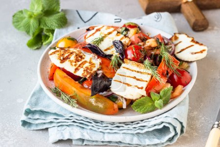 Photo for Tomato, baked pepper and onion salad with grilled haloumi cheese (halloumi). Keto diet, healthy food. - Royalty Free Image