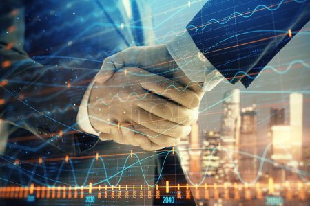 Photo for Double exposure of financial chart on cityscape background with two businessmen handshake. Concept of financial analysis and investment opportunities - Royalty Free Image