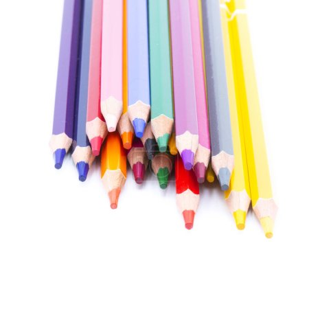 close-up view of colored pencils on white background