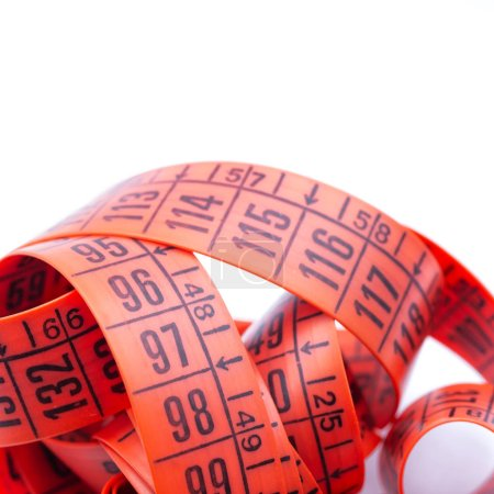 blur red  tape measure in the white light like concept of diet and lenght tool   and copy spac