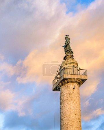 Low angle shot of trajan column and Santa Maria di Loreto dome church at Rome city, Italy