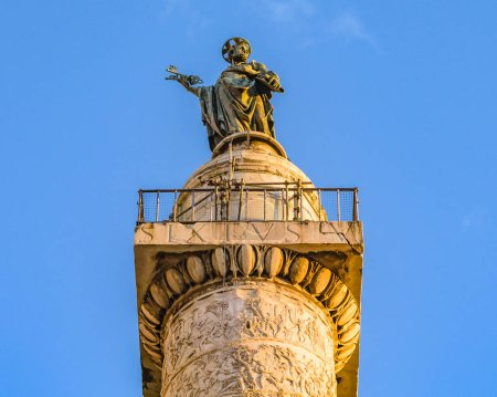 Low angle shot of trajan column over blue sky at Rome city, Italy