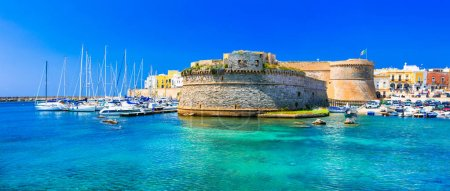 Photo for Landmarks of Italy - coastal town Gallipoli in Puglia, view of old castle and boats. - Royalty Free Image