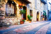 charming streets of medieval italian town Assisi in Umbria.