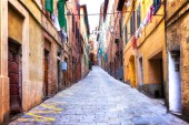 Traditional Italy - old narrow streets of medieval town Siena in Tuscany.