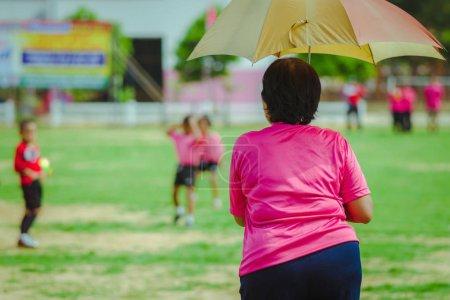 Female Teachaer is coaching children
