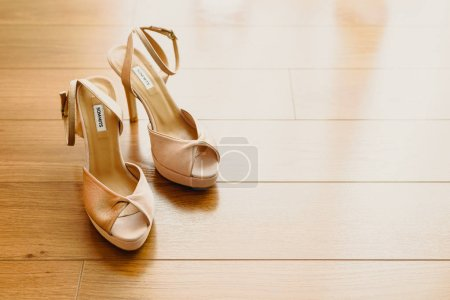 Wedding shoes on their wedding isolated in a room...