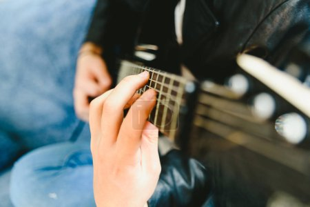 Photo for Placing the fingers on a guitar to play some notes by a professional guitarist. - Royalty Free Image
