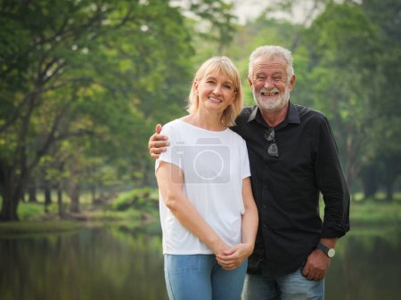 Photo for Portrait of Senior couple retirement Man and woman happy in park together - Royalty Free Image