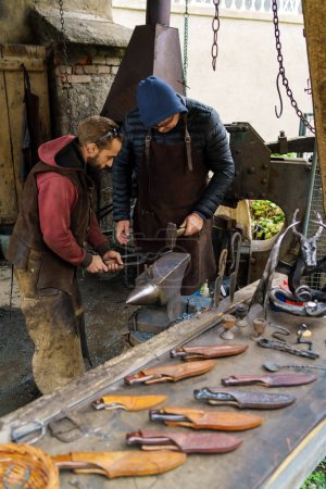 Photo for Graz, Austria - October 23, 2017: Demonstrative performance of a blacksmith in Riegersburg Castle and hand-forged knives - Royalty Free Image
