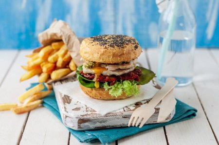 Photo for Italian Style Turkey Burger with French Fries - Royalty Free Image