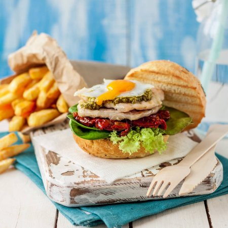 Photo for Italian Style Turkey Burger with French Fries, square - Royalty Free Image