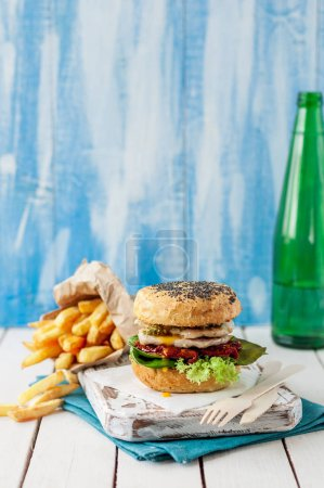 Photo for Italian Style Turkey Burger with French Fries, copy space for your text - Royalty Free Image