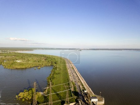 Aerial view to the road going to the Novosibirsk hydroelectric power station on a sunny summer windless day