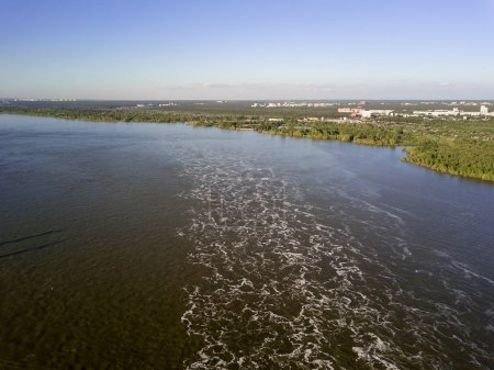 Aerial view to the boiling water from the Novosibirsk hydroelectric power station on a sunny summer windless day