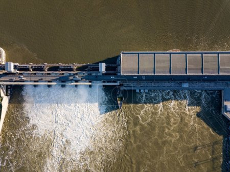 Aerial view to the Novosibirsk hydroelectric power station on a sunny summer windless day