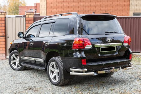 Photo for Novosibirsk, Russia - 09.26.2020: Front view of Toyota Land Cruiser 200 in black color after cleaning before sale in a sunny day on parking. Japan SUV car. - Royalty Free Image