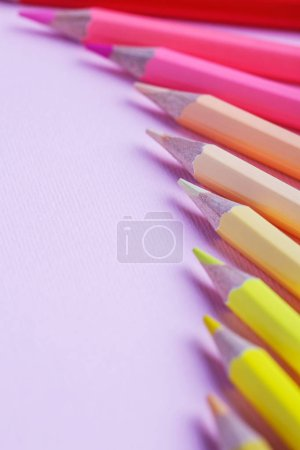 Photo for Bright color palette of crayons on the table. Colorful art studying and painting process. 1 September concept postcard, teachers day - Royalty Free Image