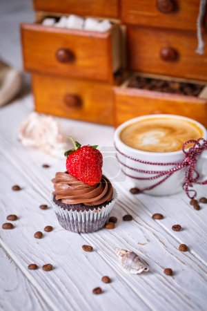 Photo for Chocolate cake with strawberries and a coffee drink on the table. - Royalty Free Image