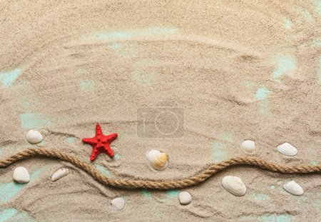 Photo for Red starfish, seashells and sea rope on sand on turquoise wooden background. Top view. Place for text. - Royalty Free Image