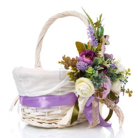 Photo for Provence Easter floral arrangement on a white wicker basket with a vine. Isolated. Easter Basket. Side view. - Royalty Free Image