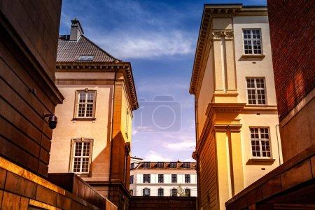 Urban scene with buildings and blue cloudy sky in Copenhagen, denmark