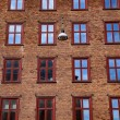 Full frame of city building brick wall with window...