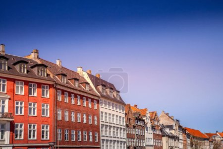 Urban scene with colorful buildings and clear blue sky in Copenhagen, denmark