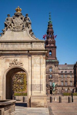 Urban scene with historical Christiansborg Palace and blue sky in Copenhagen, denmark