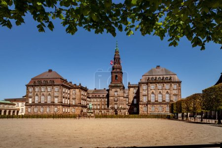 Urban scene with historical Christiansborg Palace and blue sky in Copenhagen, denmark