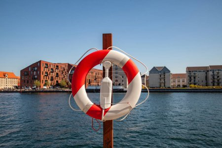 Close up view of floating ring with city river and buildings on background in Copenhagen, Denmark