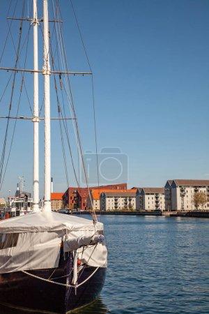 COPENHAGEN, DENMARK - MAY 6, 2018: yacht moored in harbour and beautiful cityscape in copenhagen, denmark