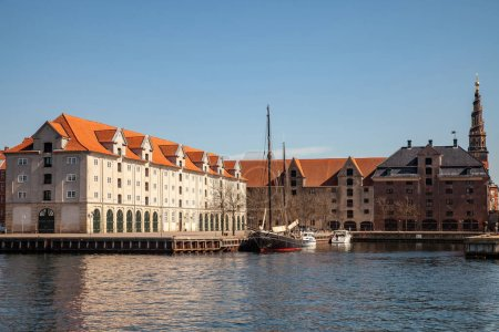 COPENHAGEN, DENMARK - MAY 6, 2018: historical buildings and boats moored in harbor, copenhagen, denmark