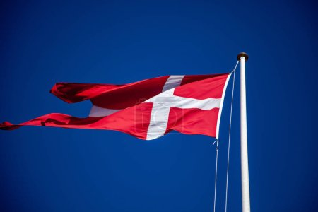 Photo for Low angle view of flag of denmark waving against blue sky - Royalty Free Image