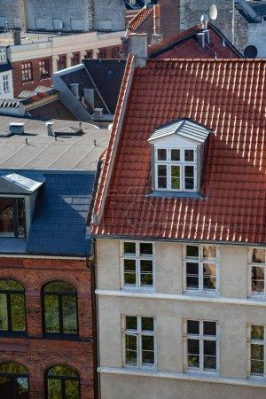 aerial view of various buildings and rooftops in copenhagen, denmark