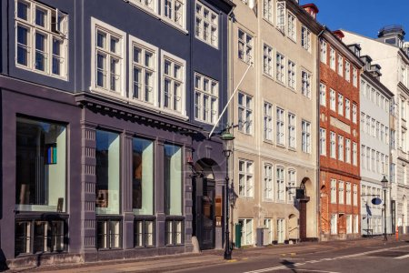 empty street with beautiful colorful buildings in copenhagen, denmark