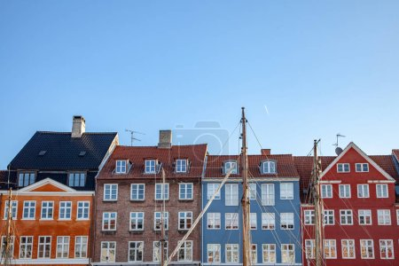 beautiful colorful historical buildings against blue sky in copenhagen, denmark
