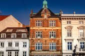 beautiful historical buildings against blue sky at sunny day, copenhagen, denmark