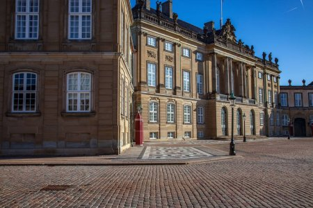 Empty square with beautiful Amalienborg palace and street lamps, copenhagen, denmark