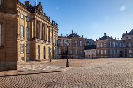 Photo for Beautiful Amalienborg palace and historical buildings and street lamps on empty square in copenhagen, denmark - Royalty Free Image