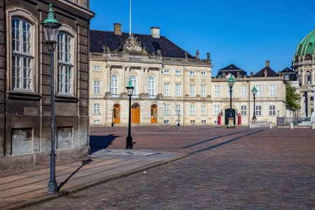empty street and square with historical buildings and cathedral in copenhagen, denmark