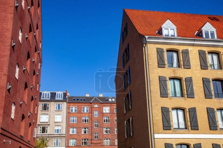 low angle view of beautiful historical buildings and blue sky, copenhagen, denmark